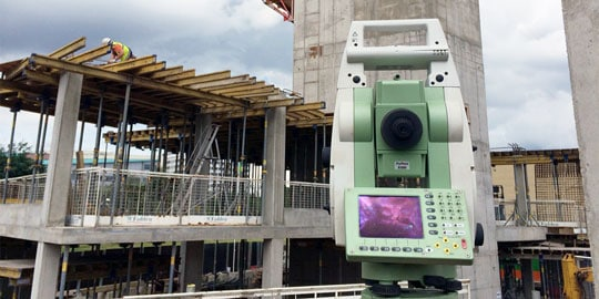 Image of building site and survey equipment