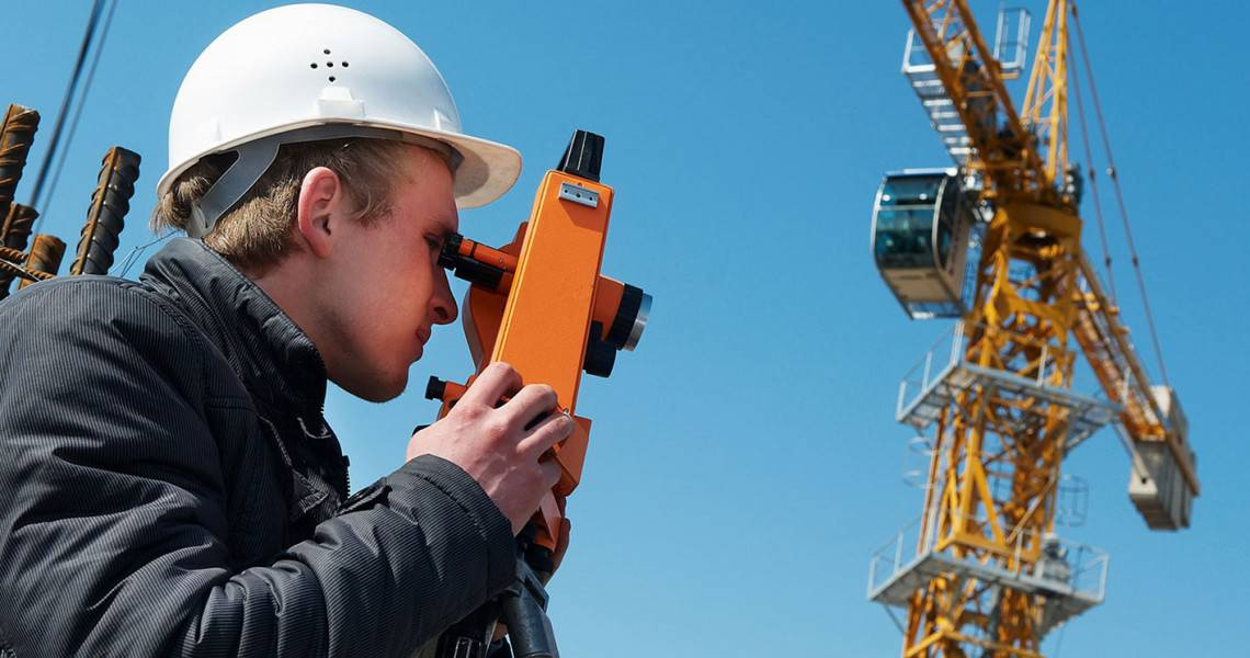 A young person using a theodolite